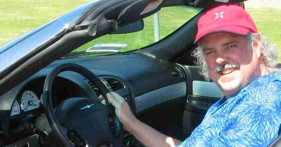 Chris sitting in Ford T-Bird